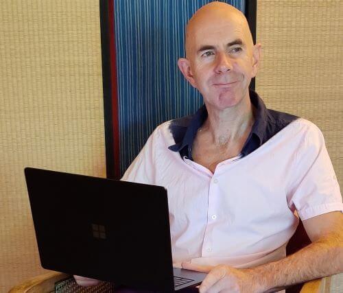 Stephen-sitting-laptop